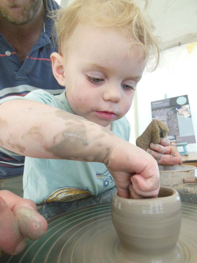 Babies get the opportunity to play with clay at Eastnor Pottery Herefefordshire