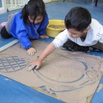 children playing with clay slip learning how to form letters and numbers and shapes