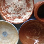 terracotta bowls and cups made by students on potter's wheel courses at Eastnor Pottery