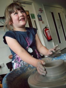 Children's summer holiday potter's wheel workshops at Eastnor Pottery, Herefordshire