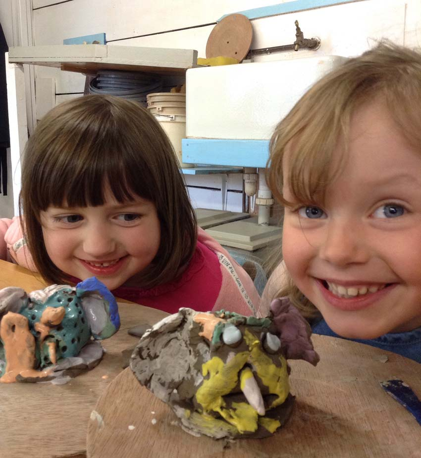 Birthday party pottery creations and their young makers at Eastnor Pottery
