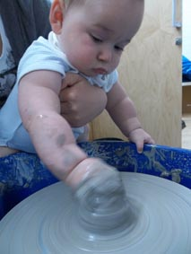 clay baby on a potter's wheel, workshop led by Jon Williams, the Flying Potter from Eastnor Pottery
