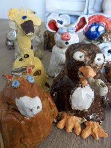 Coil pot creations made by children attending Eastnor Pottery's 1/2 term workshops