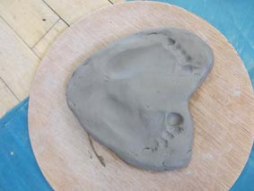 impressions taken from a clay babies pottery session in birmingham led by jon williams from eastnor pottery