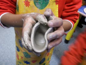 clay pot made on the wheel by a young potter