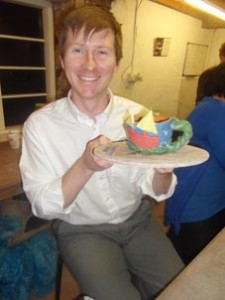 corporate hospitality at its best. a pottery participant with his splendid coil pot made at eastnor pottery