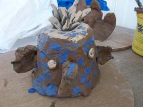 a clay owl made by a student from alderman knight special school in tewkesbury. she was part of a group working with jon the potter at eastnor pottery and the flying potter