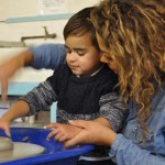 Mother and son on pottery wheel at Eastnor Pottery