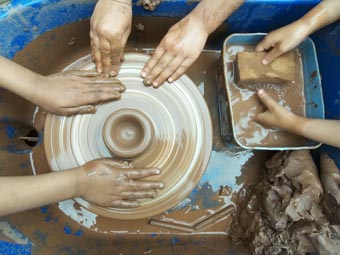 very young potters at washwood heath nursery school get to grips with the potters wheel