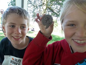 a couple of children enjoy working with clay at mudrunner oblivion event in eastnor deer park