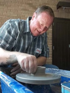 gerry the photographer trys his hand at pottery on the potter's wheel
