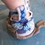 sticky clay stuck to sole of child's shoe at badsey village hall
