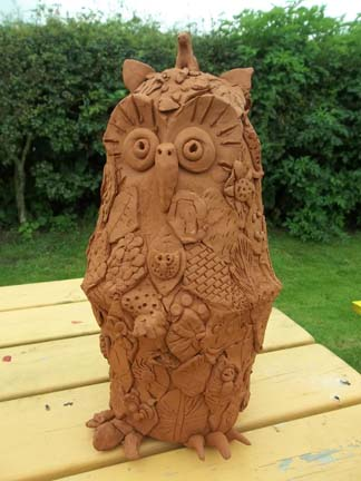collaborative terracotta owl made by jon the potter from eastnor pottery and parents children at bosbury primary school