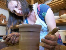 a potter's wheel weekend workshop participant at eastnor pottery herefordshire