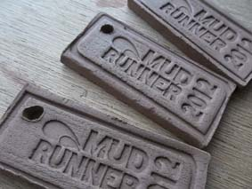 pottery medals for mudrunner classic race manufactured by eastnor pottery herefordshire