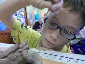 aliens made from clay at st peters primary school in bromyard herefordshire