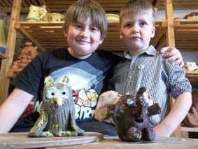 max & joe proudly present their colourful critters made at max's pottery birthday party at eastnor pottery in herefordshire