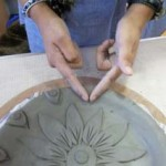 a finely decorated clay plate made by a new parent at washwood heath nursery school in birmingham