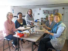 group of friends get creative at eastnor pottery in herefordshire