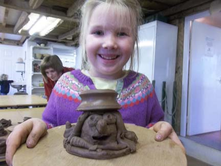 scarecrow candle holder made at eastnor pottery and the flying potter made by kids