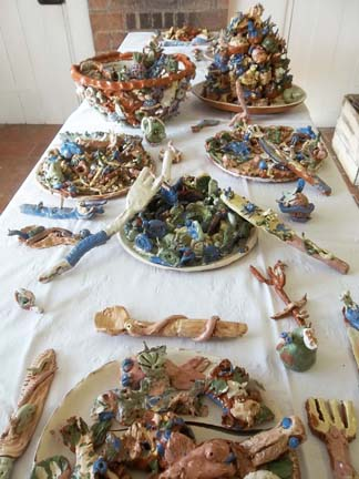 a ceramic meal of putrid pizza and mouldy fruit made by visitors to eastnor castle summer 2012