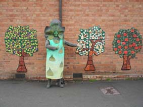 fruit tree tile panels made from pottery by school children