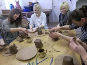 staff from ashton under hill first school take part in creative training and development at eastnor pottery herefordshire