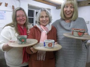 three life long friends enjoy making and painting pottery at eastnor pottery