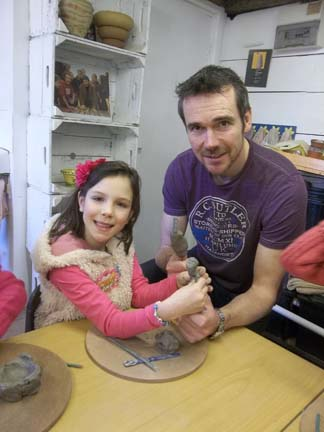 dad and daughter give a big pottery thumbs up to our children's pottery birthday parties at eastnor pottery and the flying potter