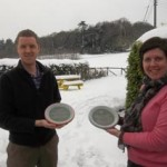 two workshop participants learn how to make a pottery plate using clay at eastnor pottery