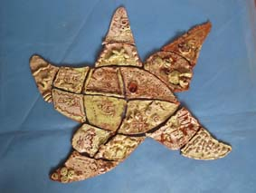 jon the potter worked with charford first school to make a series of tile panels based upon a sealife theme