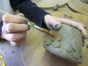 paw print coil pot made by a student from vale of evesham special school on a trip to eastnor pottery herefordshire