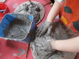 messy play session facilitated at ledbury primary school nursery by artist jon williams from eastnor pottery and the flying potter
