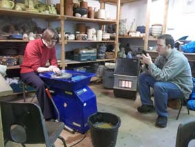 sue has always wanted to try the potter's wheel here she is at eastnor pottery making her dream come true