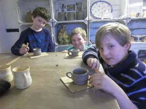 10 year old boys making pottery at eastnor pottery and the flying potter herefordshire