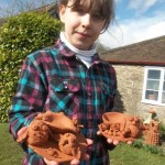 child collecting her pottery she made at eastnor pottery and the flying potter