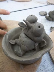 clay pinch-pt bird in a nest made by student at vale of evesham school worcestershire