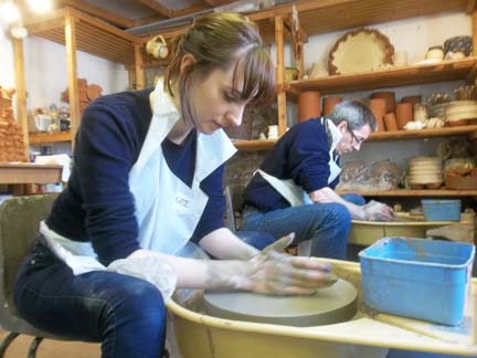 corporate clients visit eastnor pottery for potter's wheel activity