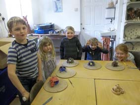 Elliot celebrated his birthday at Eastnor Pottery by making and painting clay dragons