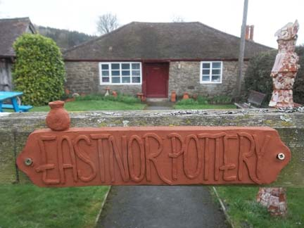 Terracotta Pottery sign made by Erika on her work experience last year at Eastnor Pottery