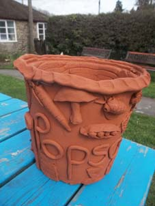Al and his lovely family spent anafternoon at the Pottery making this wonderful collaborative plant pot