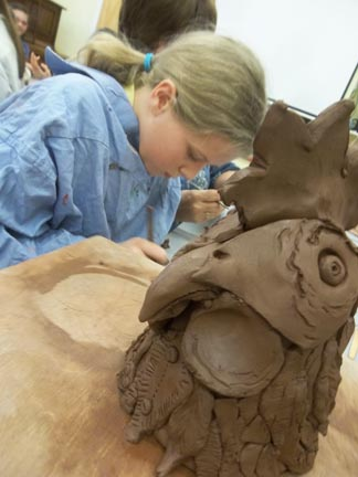 Head of a clay chicken made by Jon Williams and all the pupils at Madresfield Primary School