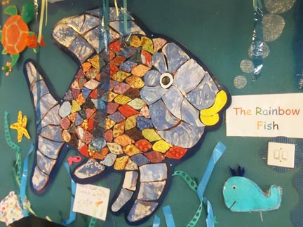 rainbow fish tiles made by children at Leominster infants school wih jon williams from eastnor pottery herefordshire