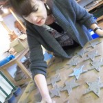 Tracey making pottery stars for the children in her class as an end of term gift for them all
