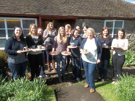 Susan and her hen party pose for a picture outside Eastnor Pottery in Herefordshire