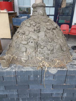 Clay bread oven made by Jon Williams Andy cox peel and the children at Brearley & Teviot Nursery School in Birmingham