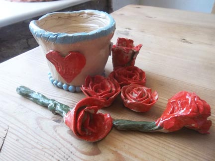 fired pottery roses made by a pottery hen party at eastnor pottery in the West Midlands