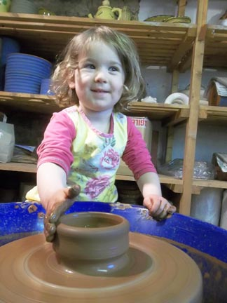 participant making a pot at our strawberries & Cream children's pottery workshops in half term