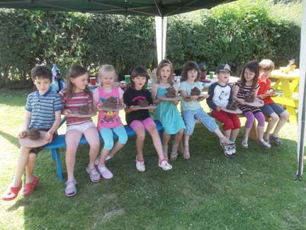 A group of 7 year olds celebrate their friends birthday at Eastnor Pottery nr Ledbury