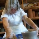 Jacqui makes a pot on the potter's wheel to celebrate her birthday